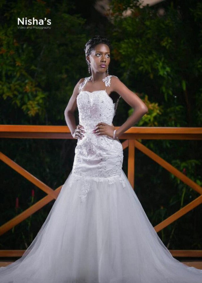 A bride clad in a strap fitting mermaid wedding gown from Nisha's Bridal